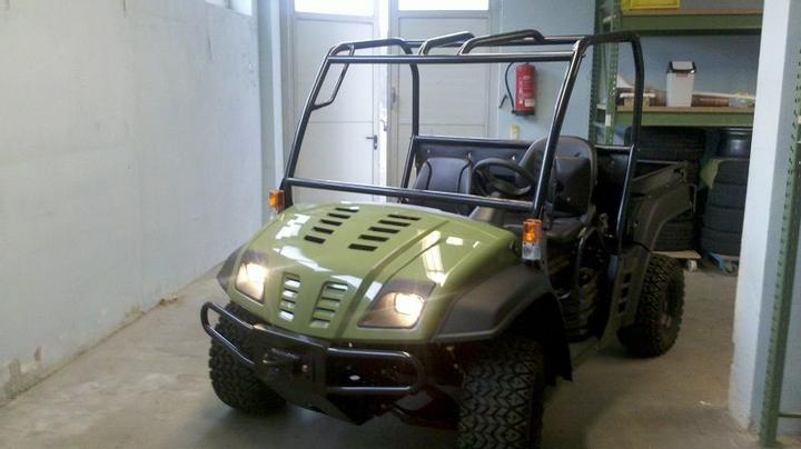 A used ATV / Quad by John Deere.