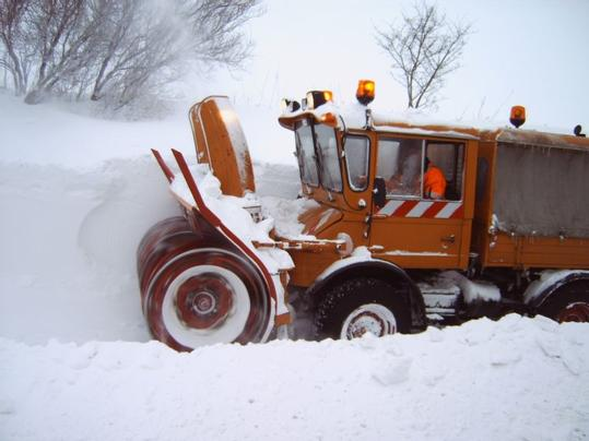 A snow remover at work.